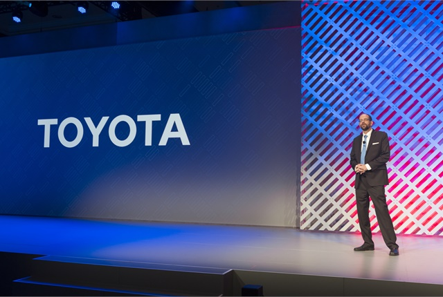 <p>Dr. Gill Pratt, shown here during a presentation at CES 2016, is CEO of Toyota Research Institute. TRI has research facilities in California, Michigan and Massachusetts. <em>Photo courtesy of Toyota.</em></p>