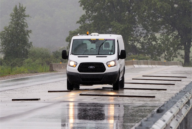 The 2014 Transit is the first vehicle Ford Engineers are testing using the company's robotic vehicle testing system.