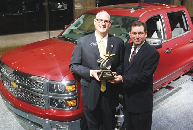 (Left) Ed Peper, U.S. vice president of GM Fleet & Commercial Sales received the Truck of the Year award from Robert Brown Jr., great lakes sales manager for AF.