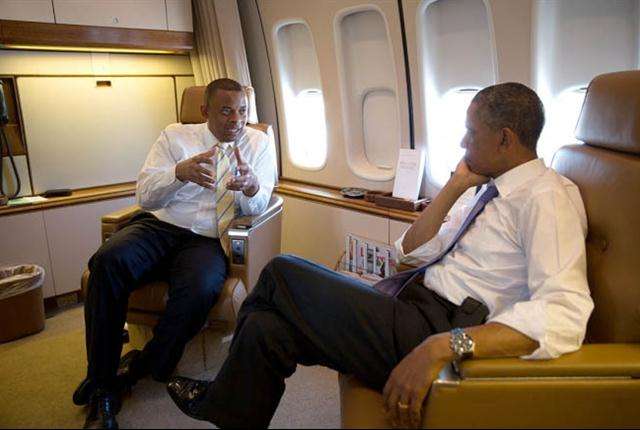 President Barack Obama talks with Transportation Secretary Anthony Foxx aboard Air Force One during the flight to Jacksonville, Fla., where the president called for more infrastructure investment to create jobs and support the middle class.(White House photo)