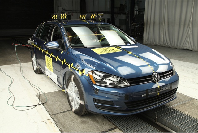 With dummies in place, a test vehicle is prepared for crash testing. Photo courtesy of NHTSA.