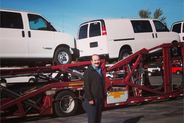 CEO Pablo Acedo poses with VIA eREV vans. Photo courtesy of VIA.