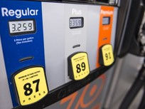 Gasoline Falls 3 Cents to $2.45 Per Gallon