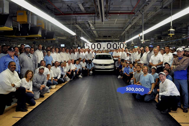 Volkswagen Chattanooga factory workers pose with Passat. Photo courtesy of Volkswagen.