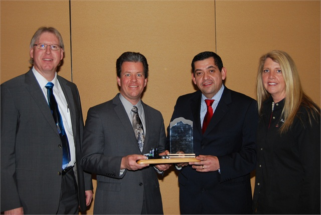 """Wabco Reman Solutions was named the """"Heavy Duty Remanufacturer of the Year"""" Award winner by the Heavy Duty Remanufacturing Group. Accepting the award from Sandra Standley, right, chairman of HDRG, is a team from Wabco Reman Solutions, including (left to right) Joe Kripli, Global Business Development Leader; Jeffrey Stukenborg, Chief Engineer; and Salvador Munoz, Reman Business Leader."""