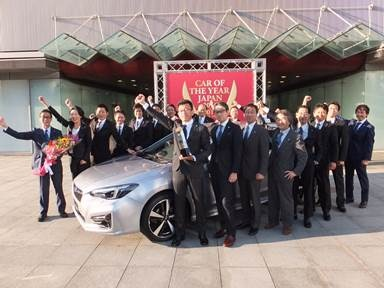 Subaru Impreza chief engineer Kazuhiro Abe celebrates the Impreza's honor as Japan's COTY with designers, engineers, and PR communications staff. Photo: Japan COTY