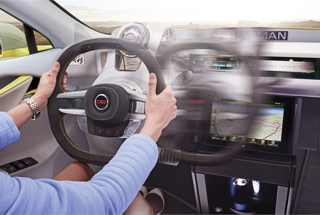Occupants can become drivers in the Rinspeed XchangE concept by simply moving the steering wheel from the center of the console and back again.