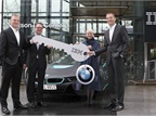 BMW and IBM executives celebrate their companies' new collaboration at the Watson IoT headquarters in Munich, Germany. IBM's Harriet Green and Niklaus Waser present a symbolic key to BMW's Marcus Raisch and Alexander Kraubitz. Photo courtesy of IBM.