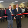 Ron Mawaka (left), CEO, and Scott Mawaka, president and COO, cut the ribbon to celebrate the company's office expansion.