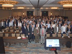 "The attendees of the Global Fleet Conference pose for a ""class photo"" after the opening keynote presentation by G. Mustafa Mohatarem, Ph.D., chief economist, General Motors."