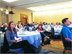 "Conference attendees listened to Watson""s keynote."