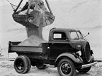 A 1939 Ford Cab Over Engine Dump Truck.