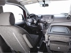 The front passenger seat can fold down to provide a work surface.