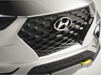 The upright hexangoal grille features cascading lines framing the