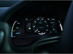 Depending on the selected drive mode, background color and gauges are