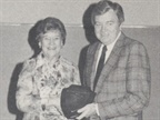 Shirley Rupp of Olympia Dodge poses with R.T. Cox of Chrysler Corp.