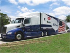 A complete shot of the Cummins Peterbilt SuperTruck at a rest area on