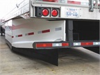 The rear section of the trailer side skirt is tapered inward, roughly