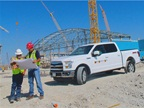 A 2015 Ford F-150 truck at the construction site of the Dallas Cowboys