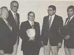 Nick Monteleone of JM Pontiac (second from right) receives the top