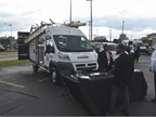 Fleet customers check out a Ram ProMaster van in the upfitter display