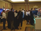 Attendees mingle in the exhibition showroom at CAR 2018 in Caesars