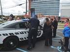 A police officer takes a closer look at the Dodge Charger Pursuit law