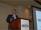 Bobit Business Media Group Publisher Sherb Brown introduces a speaker.