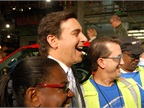 CEO Mark Fields poses with happy Ford Rouge plant employees after the