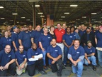 Auto Truck Group hired 35 more technicians (wearing blue shirts) at