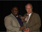 Mike Reid of Toyota Financial Services (left) was honored as Consignor