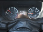 The instrument cluster includes a speedometer, tachometer, and
