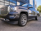 The Denali package adds a chrome grille, LED front headlights, and