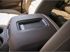 A center console mat can wirelessly charge phones that are compatible