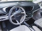 Standard interior features include a three-zone climate system, heated