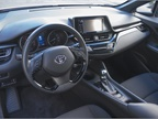 A leather-trimmed steering wheel offers controls for phone, voice,