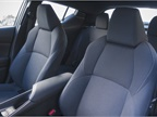 Fabric-trimmed front bucket seats can adjust six ways.