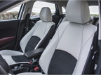 Leather seating surfaces include suede inserts.