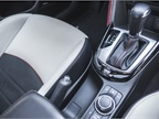 Cup holders are positioned under the retractable arm rest.