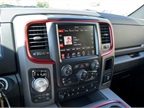 Crimson red trim outlines the infotainment system and air vents.