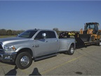 A 2016 Ram 3500 Limited Crew Cab 4X4 Long Box towing a 27,675 pound