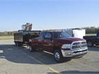 A 2016 Ram 3500 Big Horn Crew Cab 4X4 Long Box towing a 20,820 pound