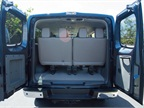 The van offers three rows of seating and a rear cargo space for