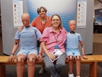 Attendees take a photo with Ford crash test dummies.