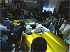The press clamoring to get a shot of the golden LF-C2 concept car