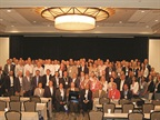 "Attendees of the third annual Global Fleet Conference pose for a ""class"" picture to commemorate the event."