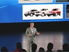 GM s Don Johnson speaks to the audience during the product preview.