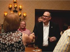 Ed Peper greets customers during a reception at the event.