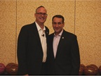 GM s Ed Peper and Duke Basketball Coach Mike Krzyzewski pose for a