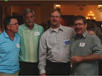 GM's Ted Pfister (third from left) spends time with Marty Burr